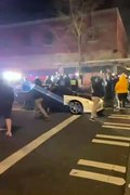 Tacoma, Wash. Police Vehicle Plows Through Mob of Downtown Street Race Spectators